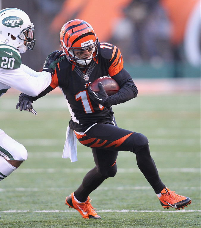 . Dane Sanzenbacher #11 of the Cincinnati Bengals runs the ball upfield during the game against the New York Jets at Paul Brown Stadium on October 27, 2013 in Cincinnati, Ohio.  (Photo by John Grieshop/Getty Images)