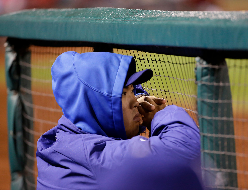 . Los Angeles Dodgers\' Hyun-Jin Ryu watches from the dugout during the ninth inning of Game 6 of the National League baseball championship series against the St. Louis Cardinals Friday, Oct. 18, 2013, in St. Louis. (AP Photo/David J. Phillip)