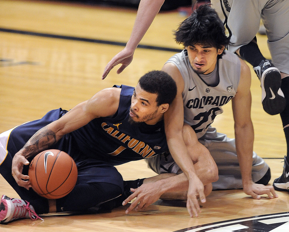 . Justin Cobbs of Cal and Sabatino Chen of CU goo to the floor during the second half of the January 27th, 2013 game in Boulder. Cliff Grassmick/The Daily Camera