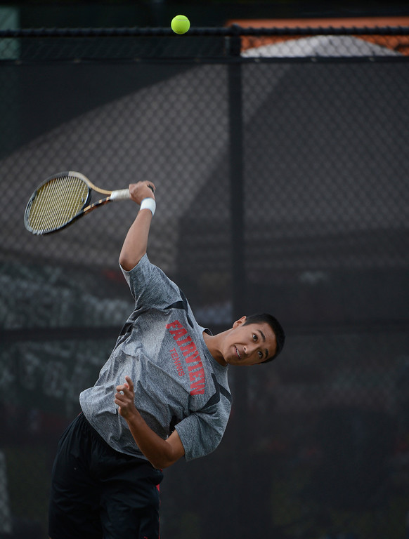 . DENVER, CO - OCTOBER 11:  Ignatius Castelino, Fairview High School, serves to opponent Nicholas Farmen, Arapahoe High School, (not pictured) during his #1 singles semi-final match at the 2013 State 5A Tennis Championships at the Gates Tennis Center in Denver, Colorado Friday morning, October 11, 2013. Castelino went on to win to reach Saturday\'s final.(Photo By Andy Cross/The Denver Post)