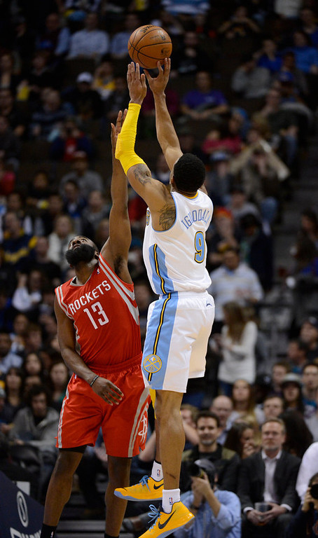 . DENVER, CO. - JANUARY 30: Denver Nuggets shooting guard Andre Iguodala (9) takes a shot over Houston Rockets shooting guard James Harden (13)  during the third quarter January 30, 2013 at Pepsi Center. The Denver Nuggets take on the Houston Rockets in NBA action. (Photo By John Leyba/The Denver Post)