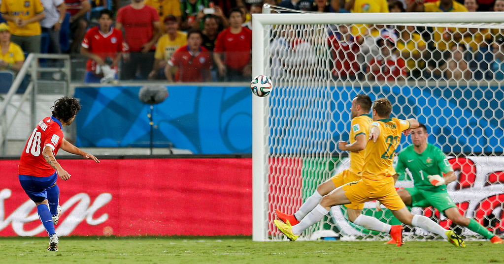 . Chile\'s Jorge Valdivia scores his side\'s second goal during the group B World Cup soccer match between Chile and Australia in the Arena Pantanal in Cuiaba, Brazil, Friday, June 13, 2014.  (AP Photo/Frank Augstein)