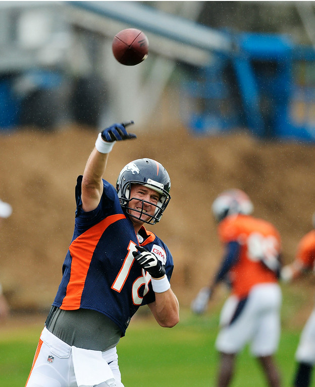 . Denver Broncos quarterback Peyton Manning (18) throws a pass in drills on day seven of the Denver Broncos 2014 training camp July 31, 2014 at Dove Valley. (Photo by John Leyba/The Denver Post)