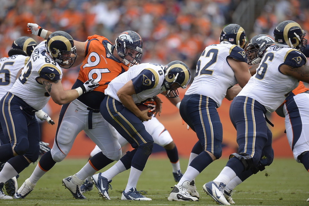 . DENVER, CO. - AUGUST 17: Denver Broncos defensive tackle Mitch Unrein (96) sacks St. Louis Rams quarterback Sam Bradford (8) during the first quarter August 24, 2013 at Sports Authority Field at Mile High. (Photo By John Leyba/The Denver Post)