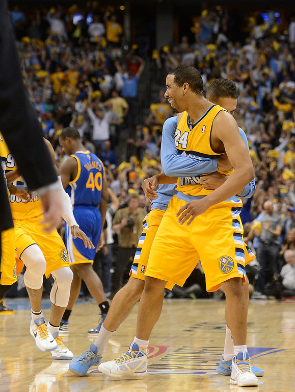 . DENVER, CO. - APRIL 20: Denver Nuggets point guard Andre Miller (24) is hugged by teammates after scoring the game-winning basket. The Denver Nuggets took on the Golden State Warriors in Game 1 of the Western Conference First Round Series at the Pepsi Center in Denver, Colo. on April 20, 2013. (Photo by John Leyba/The Denver Post)