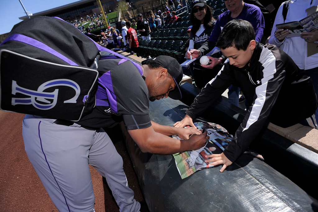 . SCOTTSDALE, AZ. - FEBRUARY 23: Colorado Rockies fan gets an autograph form Chris Nelson (4) of the Colorado Rockies before their game against the Arizona Diamondbacks February 23, 2013 in Scottsdale. (Photo By John Leyba/The Denver Post)