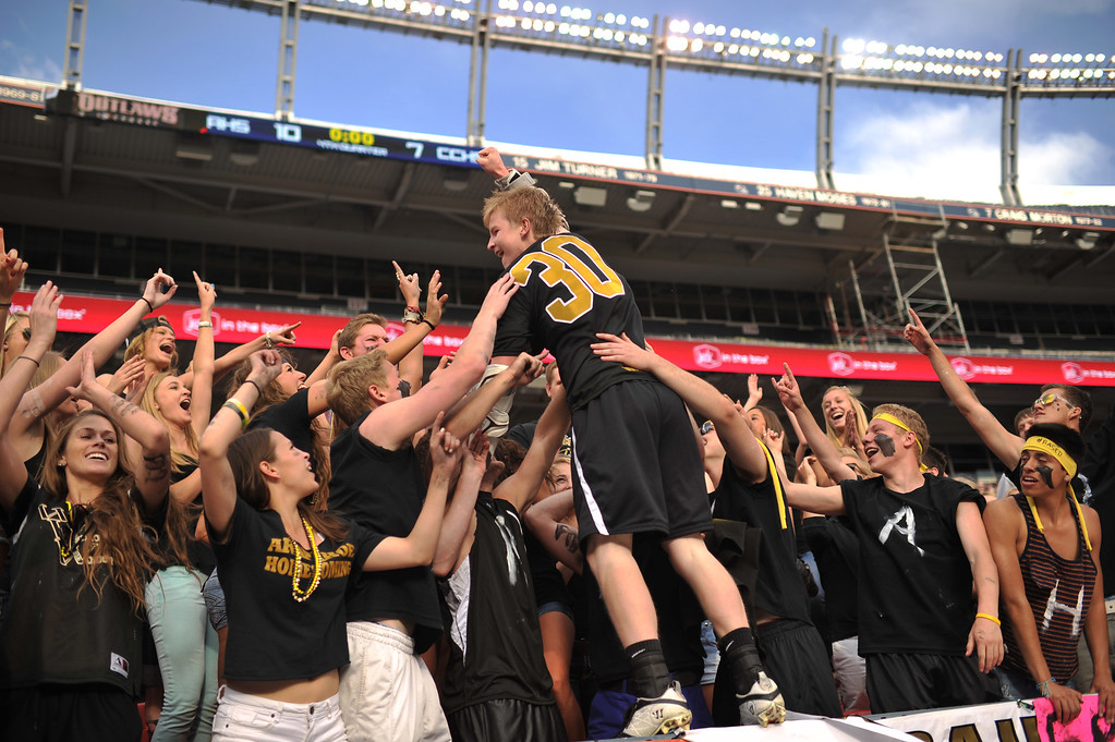 . DENVER, CO. - MAY 18 : Zach Runberg of Arapahoe High School (30) celebrates winning 5A Boy\'s Lacrosse Championship game against Cherry Creek High School with friends at Sports Authority Field at Mile High Stadium. Denver, Colorado. May 18, 2013. Arapahoe won 10-7. (Photo By Hyoung Chang/The Denver Post)