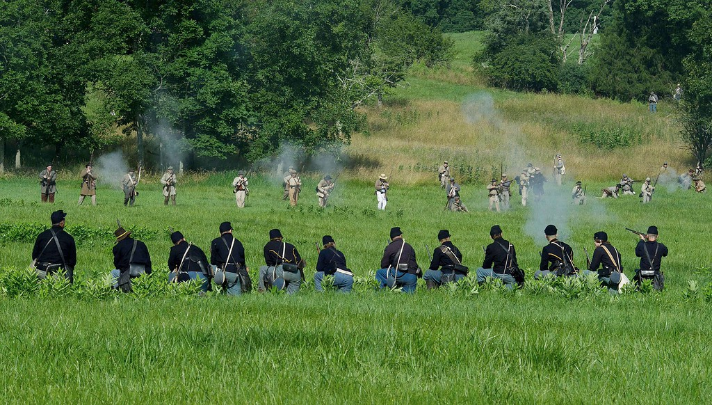 . Union soldiers (front) are fired on by advancing Confederate troops during a re-enactment of the Battle of Gettysburg on June 28, 2013 at the start of the 150th Gettysburg celebration and re-enactments in Gettysburg, Pennsylvania. Over three days, more than 10,000 re-enactors will pay tribute the major battles that took place in Gettysburg during the US Civil War 1861-1865. KAREN BLEIER/AFP/Getty Images