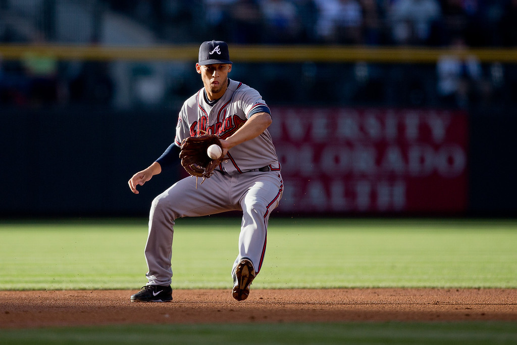 . Shortstop Andrelton Simmons #19 of the Atlanta Braves fields a ground ball on his way to throwing out Drew Stubbs (not pictured) of the Colorado Rockies for the second out of the first inning at Coors Field on June 9, 2014 in Denver, Colorado.  (Photo by Justin Edmonds/Getty Images)