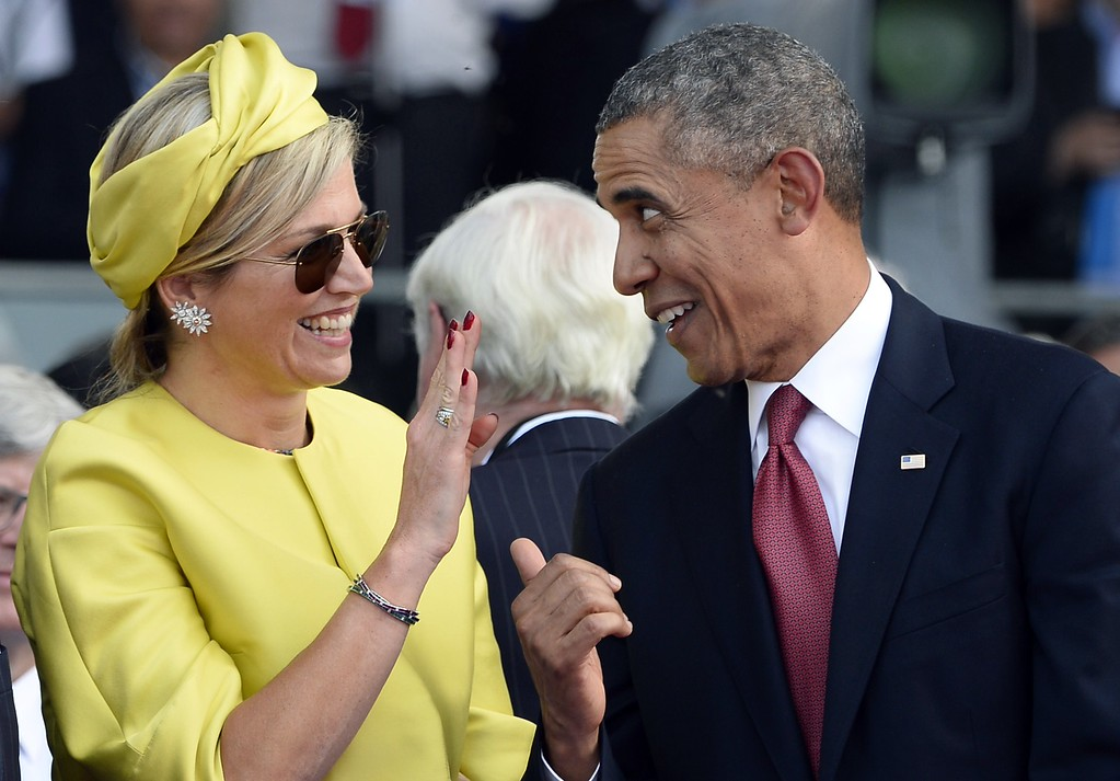 . US President Barack Obama (R) laughs with Queen Maxima of the Netherlands at the international D-Day commemoration ceremony in Ouistreham, on June 6, 2014, marking the 70th anniversary of the World War II Allied landings in Normandy.     AFP PHOTO / POOL/ALAIN  JOCARD/AFP/Getty Images