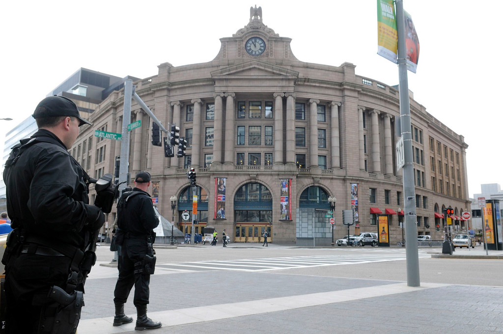 . SWAT officers from suburban communities aid Boston police officers in keeping guard at the nearly deserted South Station area of Boston, Massachusetts, April 19, 2013, as the manhunt continues for Dzhokar Tsarnaev, the remaining suspect in the Boston Marathon bombings. REUTERS/Neal Hamberg