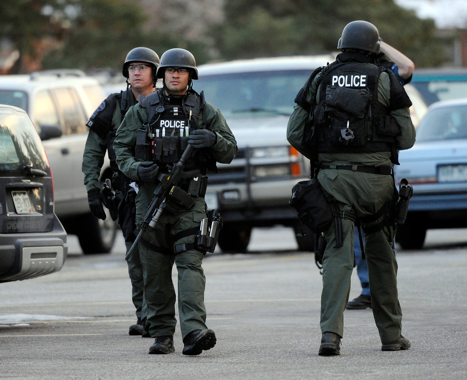. CENTENNIAL, CO. - DECEMBER 13: Arapahoe County SWAT team members searched the east lot of Arapahoe High School Friday afternoon, December 13, 2013. A shooting inside the school sent hundreds of students rushing for safety. (Photo By Karl Gehring/The Denver Post)