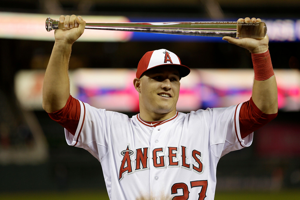 . American League outfielder Mike Trout, of the Los Angeles Angels, holds the MVP trophy after his team\'s 5-3 victory over the National League in the MLB All-Star baseball game, Tuesday, July 15, 2014, in Minneapolis. (AP Photo/Jeff Roberson)