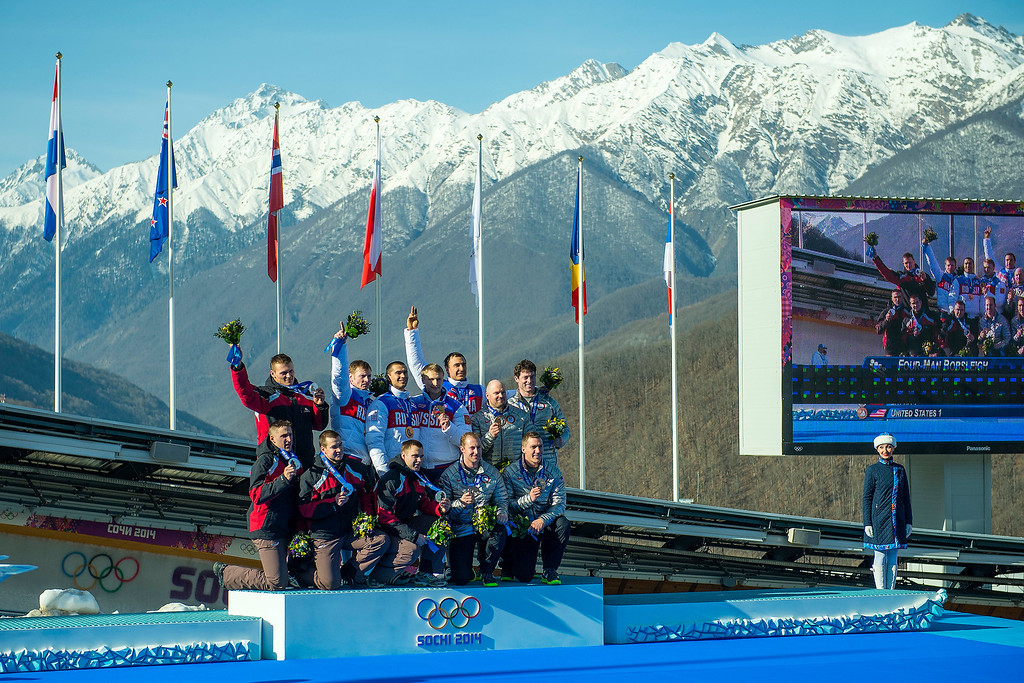 . Team Latvia, Russia and USA celebrate during the medal ceremony at the finish of the four-man bobsled at Sanki Sliding Center during the 2014 Sochi Olympics Sunday February 23, 2014. Russia won gold. Latvia won silver and USA won bronze. 