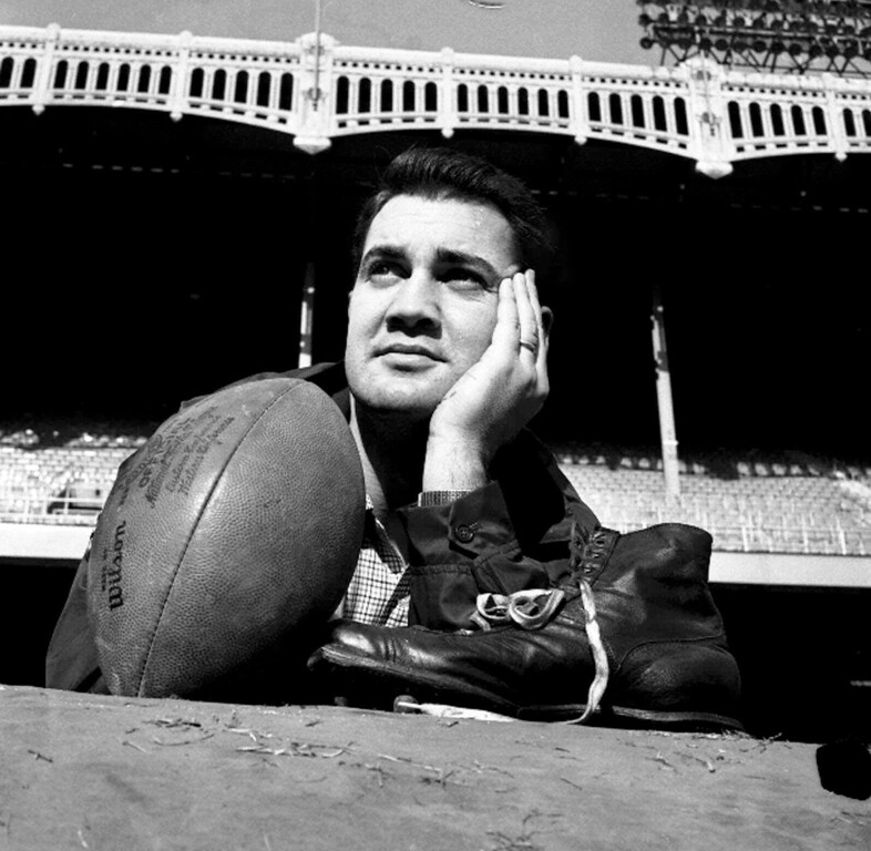 . FILE - In this Dec. 27, 1958, file photo, New York Giants place kicker Pat Summerall poses with his shoe and a football during a workout at New York\'s Yankee Stadium. Fox Sports spokesman Dan Bell said Tuesday, April 16, 2013, that Summerall, the NFL player-turned-broadcaster whose deep, resonant voice called games for more than 40 years, has died at the age of 82. (AP Photo/Harry Harris, File)