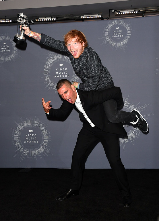 . Singer Ed Sheeran (top), winner of Best Male Video for \'Sing,\' and director Emil Nava pose in the press room during the 2014 MTV Video Music Awards at The Forum on August 24, 2014 in Inglewood, California.  (Photo by Jason Merritt/Getty Images  for MTV)