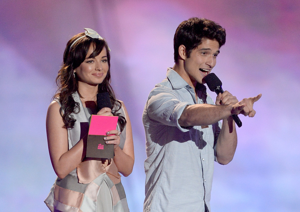 . Actors Ashley Rickards (L) and Tyler Posey speak onstage during the 2013 MTV Movie Awards at Sony Pictures Studios on April 14, 2013 in Culver City, California.  (Photo by Kevork Djansezian/Getty Images)
