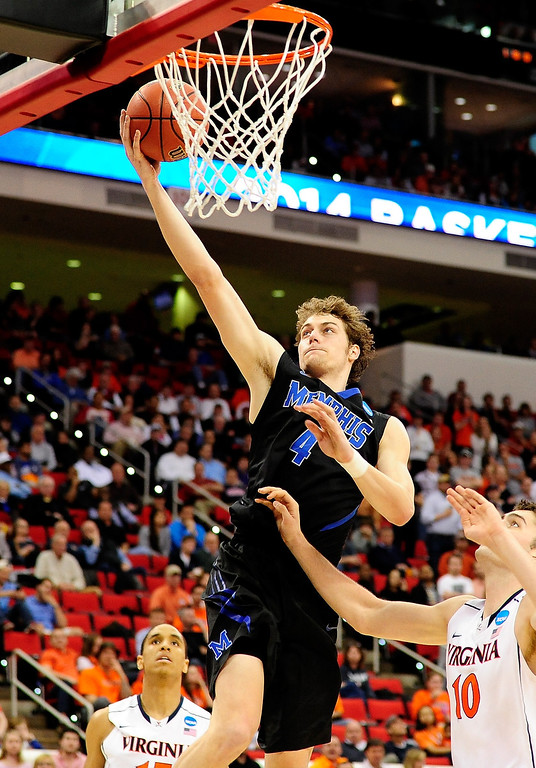 . Austin Nichols #4 of the Memphis Tigers drives to the basket against Mike Tobey #10 of the Virginia Cavaliers in the second half  during the third round of the 2014 NCAA Men\'s Basketball Tournament at PNC Arena on March 23, 2014 in Raleigh, North Carolina.  (Photo by Grant Halverson/Getty Images)