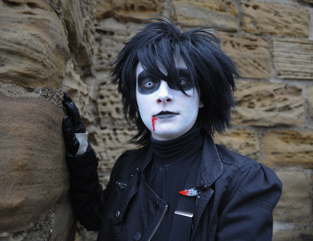 . WHITBY, ENGLAND - NOVEMBER 02: A man dressed in the style of Edward Scissorhands poses for the camera as he visits the Goth weekend on November 2, 2013 in Whitby, England. The Whitby Gothic Weekend that takes place in the Yorkshire seaside town twice yearly in Spring and Autumn started in 1994 and sees thousands of extravagantly dressed followers of Victoriana, Steampunk, Cybergoth and Romanticism visit to take part in celebrating Gothic culture.  (Photo by Ian Forsyth/Getty Images)
