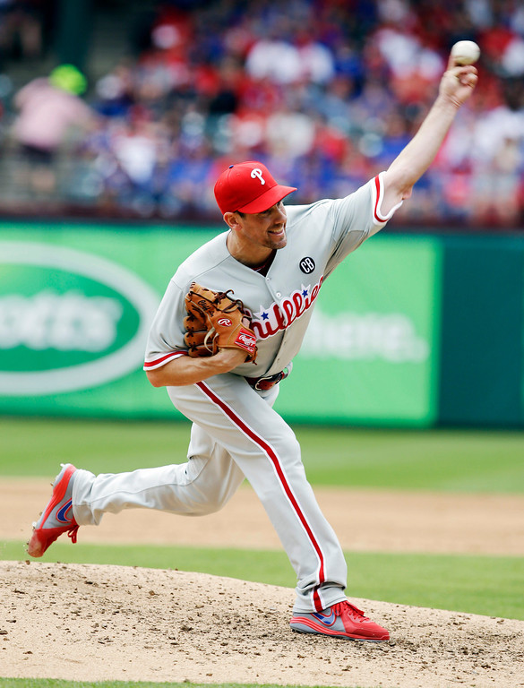 . Philadelphia Phillies starting pitcher Cliff Lee delivers the ball during the third inning of an opening day baseball game against the Texas Rangers at Globe Life Park, Monday, March 31, 2014, in Arlington, Texas.  (AP Photo/Tony Gutierrez)