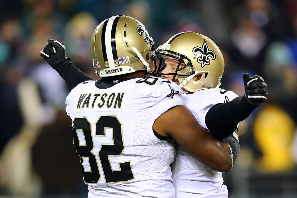. PHILADELPHIA, PA - JANUARY 04:   Shayne Graham #3 of the New Orleans Saints celebrates with teammate Benjamin Watson #82 after kicking the game winning field goal to defeat the Philadelphia Eagles in their NFC Wild Card Playoff game at Lincoln Financial Field on January 4, 2014 in Philadelphia, Pennsylvania. The New Orleans Saints defeated the Philadelphia Eagles 26 - 24.  (Photo by Elsa/Getty Images)