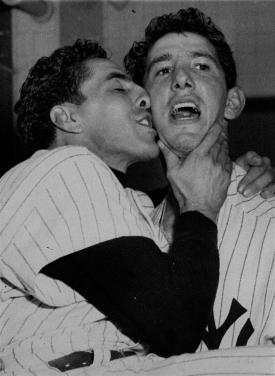 . Phil Rizzuto lays one on Billy Martin to celebrate the New York Yankees\' fifth consecutive world championship after beating the Brooklyn Dodgers in the 1953 World Series.  (AP Photo)
