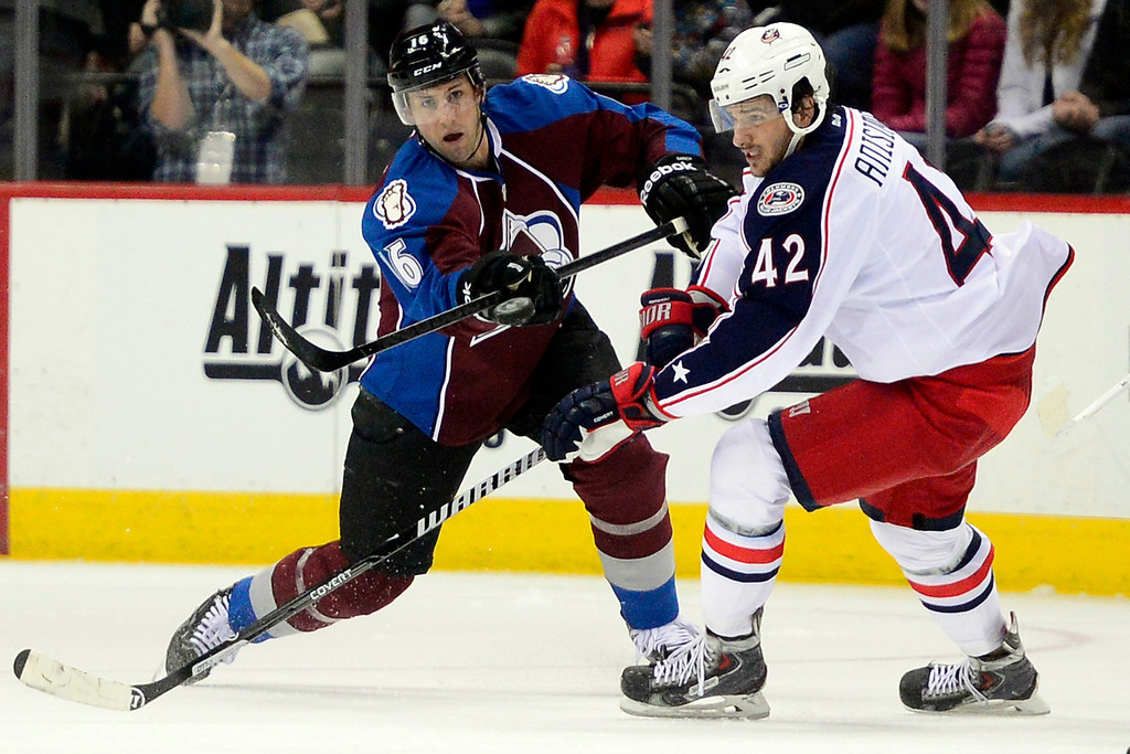 . Cory Sarich (16) of the Colorado Avalanche flips the puck past Artem Anisimov (42) of the Columbus Blue Jackets during the third period of Colorado\'s 5-3 win. (Photo by AAron Ontiveroz/The Denver Post)