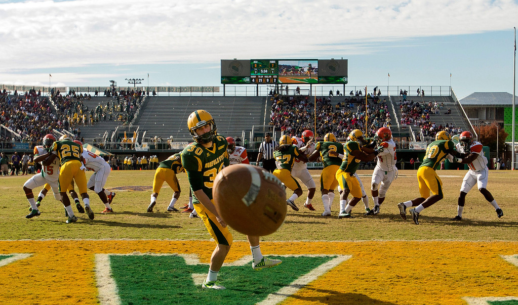 . Norfolk State punter Dalton Fraser (30) who was standing in the end zone to punt, watches a high snap from center sail out of the end zone for a safety late in the second quarter  of an NCAA college football game against Florida A&M Saturday, Nov. 2, 2013 at Dick Price Stadium in Norfolk, Va. (AP Photo/The Virginian-Pilot, Bill Tiernan)
