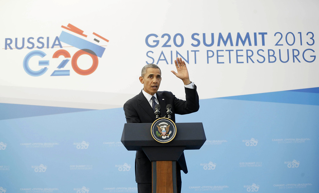 . President Barack Obama waves at the end of his news conference at the G-20 Summit in St. Petersburg, Russia, Friday, Sept. 6, 2013. (AP Photo/Pablo Martinez Monsivais)