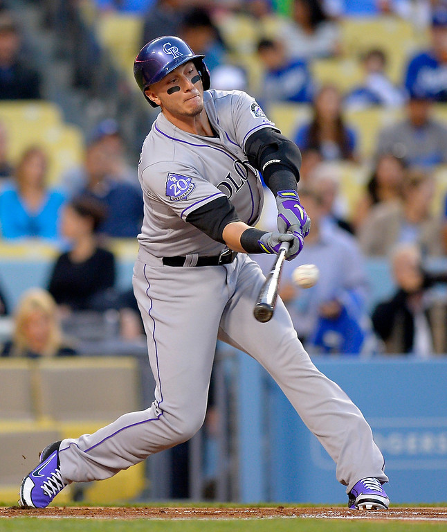 . Colorado Rockies\' Troy Tulowitzki hits an RBI double during the first inning of their baseball game against the Los Angeles Dodgers, Wednesday, May 1, 2013, in Los Angeles. (AP Photo/Mark J. Terrill)