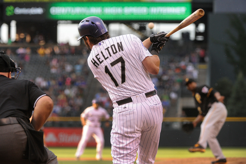. DENVER, CO. - AUGUST 09: Todd Helton drove the ball up the middle off Pirates starter Francisco Liriano in the first inning. Rosario scored from second to give the Rox a 4-0 lead. The Colorado Rockies hosted the Pittsburgh Pirates Friday night, August 9, 2013. Photo By Karl Gehring/The Denver Post