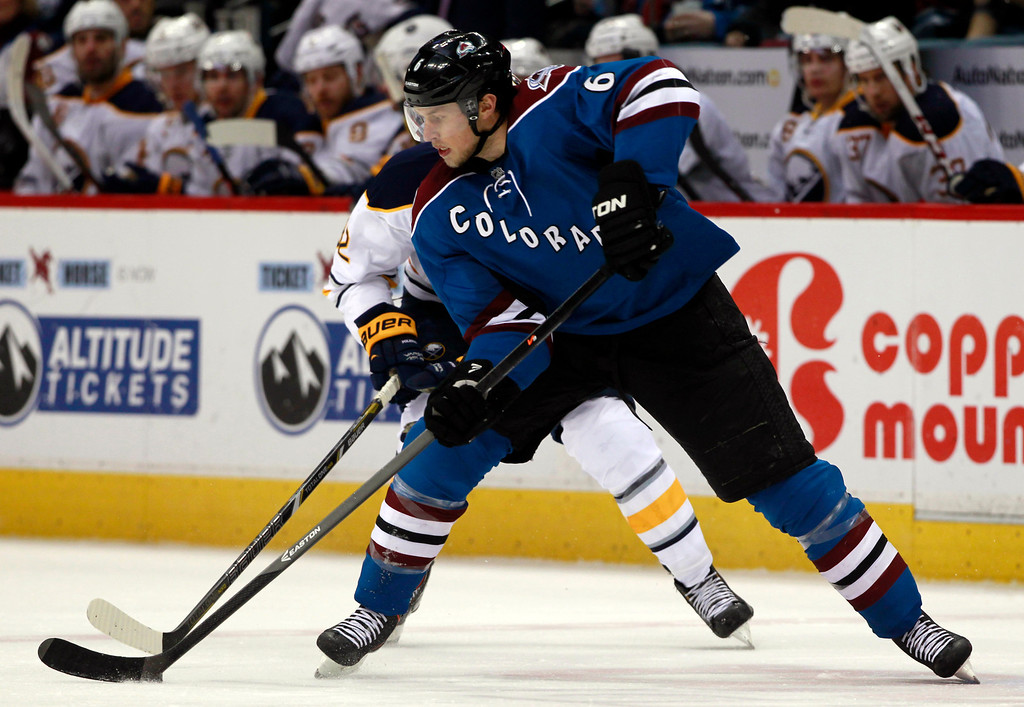 . Colorado Avalanche defenseman Erik Johnson, front, clears puck as Buffalo Sabres left wing Marcus Foligno covers in the third period of the Avalanche\'s 7-1 victory in an NHL hockey game in Denver, Saturday, Feb. 1, 2014. (AP Photo/David Zalubowski)