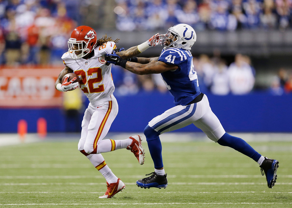 . Kansas City Chiefs wide receiver Dexter McCluster (22) runs against Indianapolis Colts strong safety Antoine Bethea (41) during the second half of an NFL wild-card playoff football game Saturday, Jan. 4, 2014, in Indianapolis. Indianapolis defeated Kansas City 45-44. (AP Photo/Michael Conroy)
