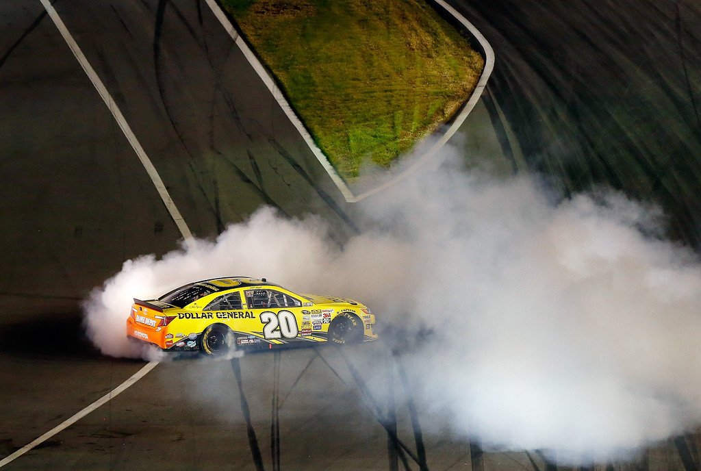 . Matt Kenseth, driver of the #20 Dollar General Toyota, celebrates with a burnout after winning the NASCAR Sprint Cup Series Budweiser Duel 1 at Daytona International Speedway on February 20, 2014 in Daytona Beach, Florida.  (Photo by Brian Lawdermilk/Getty Images)