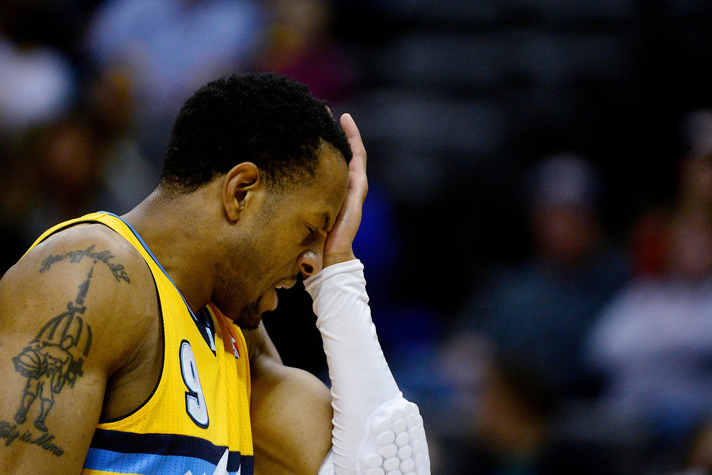 . Andre Iguodala (9) of the Denver Nuggets holds his eye after receiving contact against the Phoenix Suns during the first half of action. The Denver Nuggets play the Phoenix Suns at the Pepsi Center. (Photo by AAron Ontiveroz/The Denver Post)