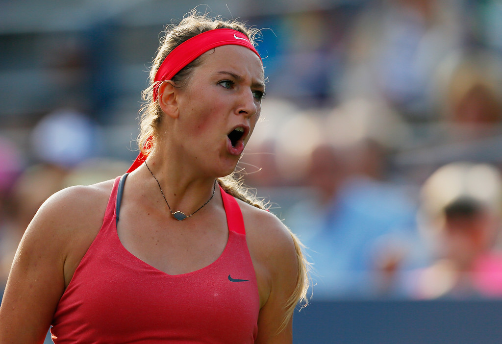 . NEW YORK, NY - AUGUST 29:  Victoria Azarenka of Belarus reacts during her women\'s singles second round match against Aleksandra Wozniak of Canada on Day Four of the 2013 US Open at the USTA Billie Jean King National Tennis Center on August 29, 2013 in New York City.  (Photo by Mike Stobe/Getty Images for the USTA)