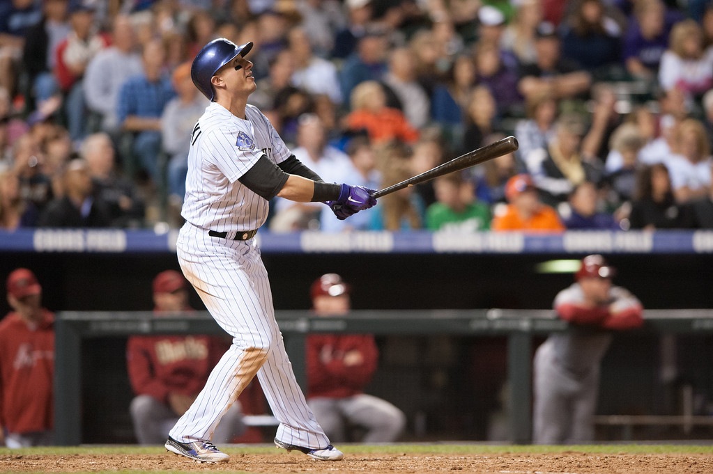 . DENVER, CO - SEPTEMBER 20:  Troy Tulowitzki #2 of the Colorado Rockies watches the flight of a seventh-inning home run against the Arizona Diamondbacks at Coors Field on September 20, 2013 in Denver, Colorado. (Photo by Dustin Bradford/Getty Images)