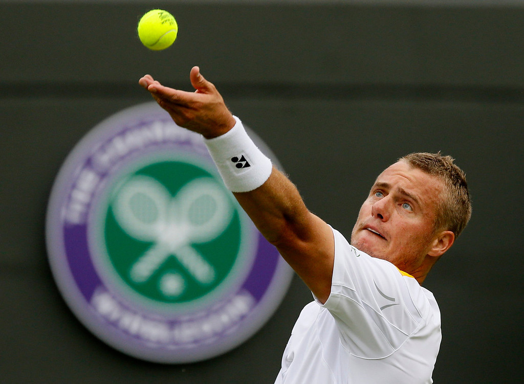 . Lleyton Hewitt of Australia serves to Stanislas Wawrinka of Switzerland during their Men\'s first round singles match at the All England Lawn Tennis Championships in Wimbledon, London, Monday, June 24, 2013.  (AP Photo/Kirsty Wigglesworth)