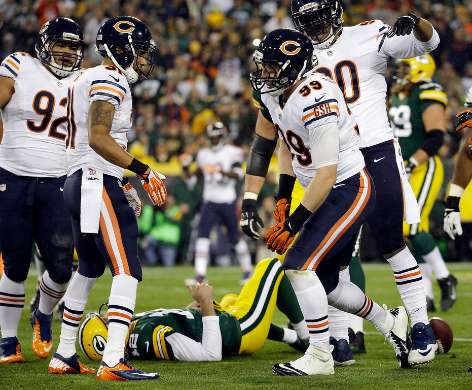 . Green Bay Packers\' Aaron Rodgers lays on the ground after being sacked by Chicago Bears\' Shea McClellin during the first half of an NFL football game Monday, Nov. 4, 2013, in Green Bay, Wis. (AP Photo/Morry Gash)