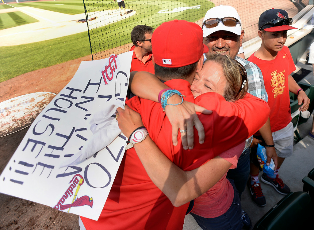 . Gina Gonzales gives her son St. Louis Cardinals starting pitcher Marco Gonzales (56) a hug after the Cardinals win over the Colorado Rockies 9-6 June 25, 2014 at Coors Field. It was Marcos major league debut. Also in the photo is his dad Frank Gonzales. (Photo by John Leyba/The Denver Post)