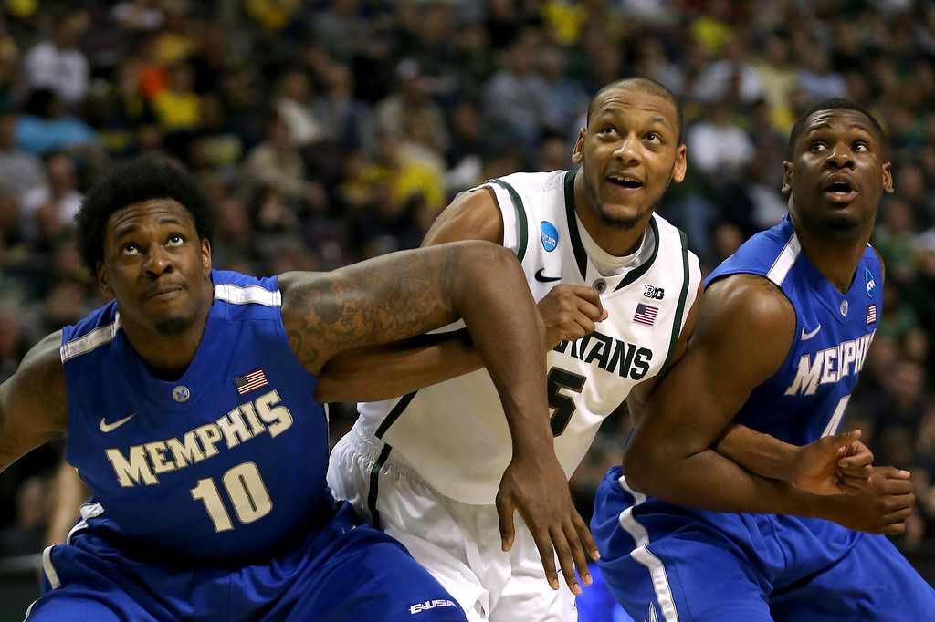 . AUBURN HILLS, MI - MARCH 23:  Adreian Payne (C) #5 of the Michigan State Spartans fights for rebound position against Adonis Thomas #4 (R) and Tarik Black #10 of the Memphis Tigers during the third round of the 2013 NCAA Men\'s Basketball Tournament at The Palace of Auburn Hills on March 23, 2013 in Auburn Hills, Michigan.  (Photo by Jonathan Daniel/Getty Images)