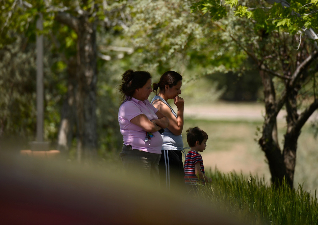 . Family members wait to get news of from their student inside Thornton High School during a lock down, May 24, 2013.(Photo By RJ Sangosti/The Denver Post)