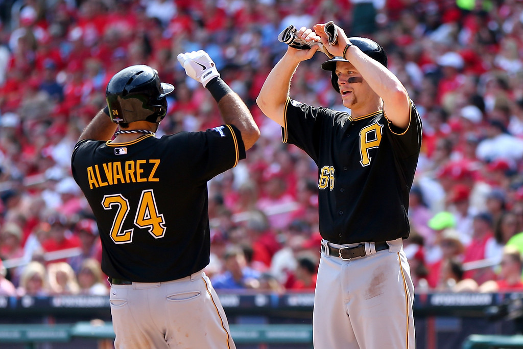 . ST LOUIS, MO - OCTOBER 04:  Pedro Alvarez #24 of the Pittsburgh Pirates hits a two-run home run in the third inning and celebrates with Justin Morneau #66 against the St. Louis Cardinals during Game Two of the National League Division Series at Busch Stadium on October 4, 2013 in St Louis, Missouri.  (Photo by Elsa/Getty Images)
