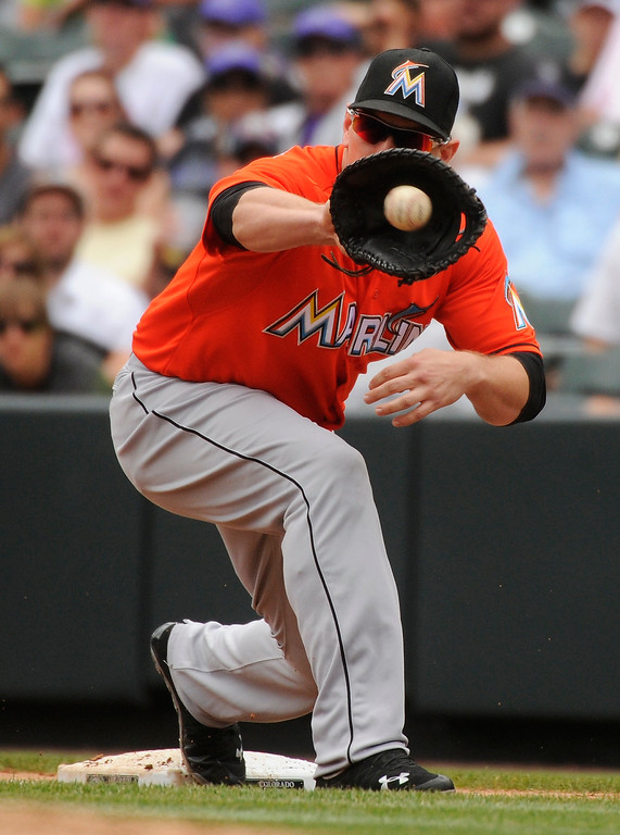 . Marlins\' infielder Logan Morrison retired Rockies batter DJ LeMahieu to end the third inning. The Colorado Rockies hosted the Miami Marlins at Coors Field Thursday afternoon, July 25, 2013. Photo By Karl Gehring/The Denver Post