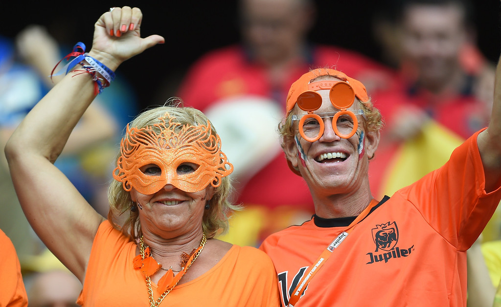 . Netherlands\' supporters wait for the start of a Group B football match between Spain and the Netherlands at the Fonte Nova Arena in Salvador during the 2014 FIFA World Cup on June 13, 2014.   AFP PHOTO / EMMANUEL  DUNAND/AFP/Getty Images