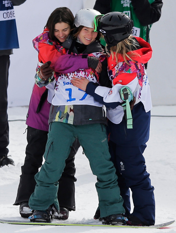 . Czech Republic\'s Sarka Pancochova, center, is embraced by Britain\'s Jenny Jones, right, and Switzerland\'s Sina Candrian after Pancochova crashed heavily during the women\'s snowboard slopestyle final at the 2014 Winter Olympics, Sunday, Feb. 9, 2014, in Krasnaya Polyana, Russia. (AP Photo/Andy Wong)