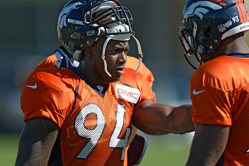 . Denver Broncos defensive end DeMarcus Ware (94) runs through drills with Denver Broncos defensive end Quanterus Smith (93) during practice at the Denver Broncos 2014 training camp August 12, 2014 at Dove Valley. (Photo by John Leyba/The Denver Post)