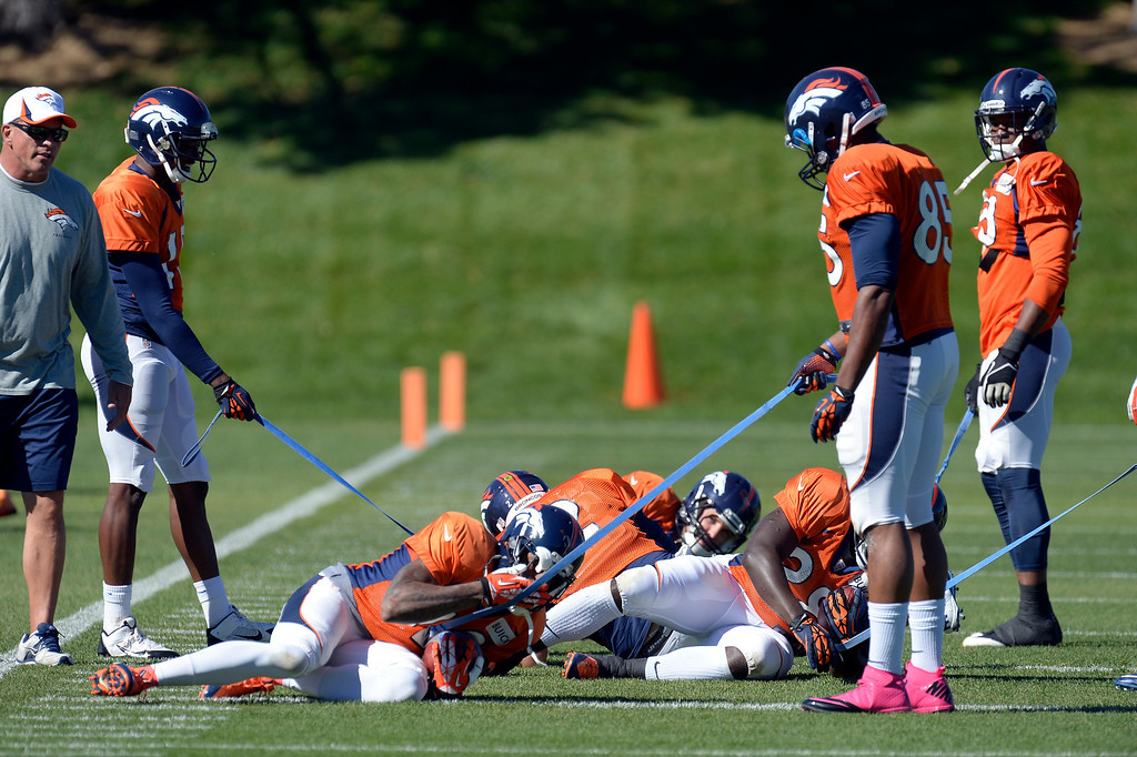 . Denver Broncos receivers and running backs work on holding on to the ball during drills at practice October 2, 2013 at Dove Valley. (Photo by John Leyba/The Denver Post)