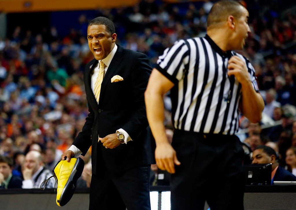. BUFFALO, NY - MARCH 20: Head coach Rob Jeter reacts while holding the lost shoe of Malcolm Moore #4 of the Milwaukee Panthers during the second round of the 2014 NCAA Men\'s Basketball Tournament against the Villanova Wildcats at the First Niagara Center on March 20, 2014 in Buffalo, New York.  (Photo by Jared Wickerham/Getty Images)