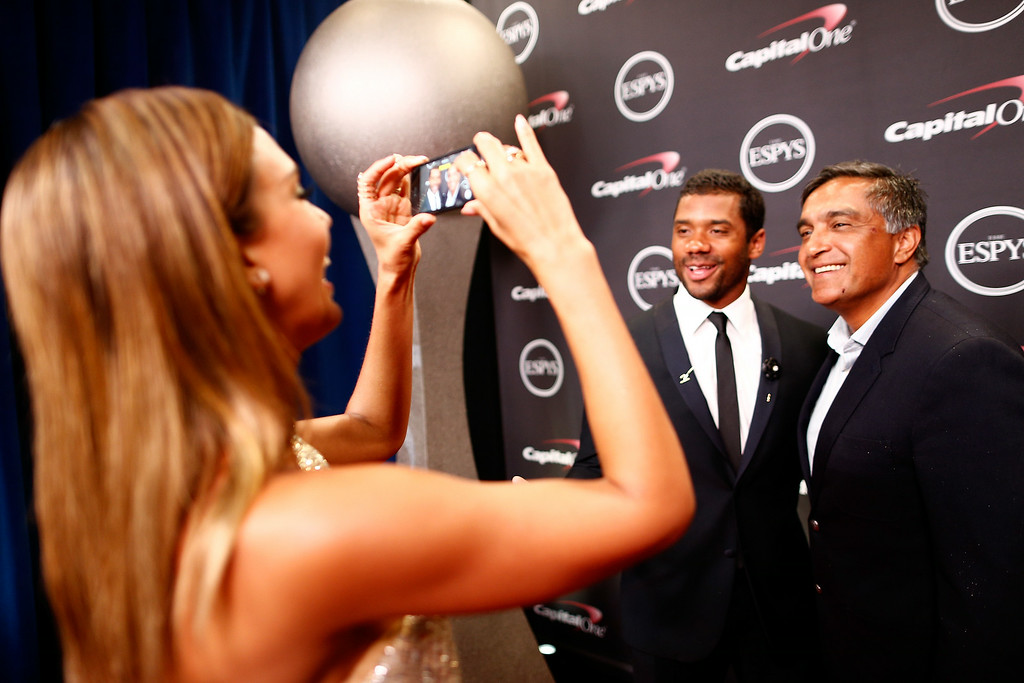 . LOS ANGELES, CA - JULY 16: NFL quarterback Russell Wilson with actress Jessica Alba and her father Mark Alba  attends The 2014 ESPYS at Nokia Theatre L.A. Live on July 16, 2014 in Los Angeles, California.  (Photo by Christopher Polk/Getty Images For ESPYS)